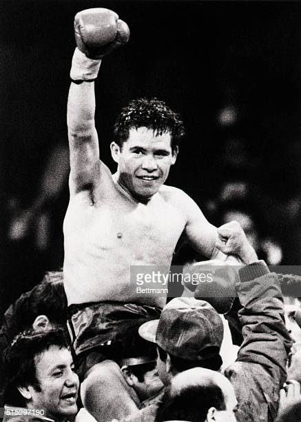 11/21/87Las Vegas Nevada Julio Cesar Chavez of Mexico raises his arm in jubilation after defeating WBA lightweight champion Edwin Rosario of Puerto...