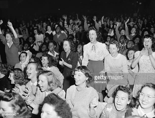 11/2/1945Gary IN Bobbysoxers screech and applaud as Frank Sinatra sings during a meeting in the Gary Municipal Auditorium when he spoke to high...