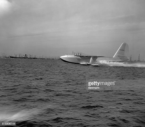 11/2/1947San Pedro CA With all eight motors roaring Howard Hughes' giant plywood flying boat skims across the surface of Los Angeles Horbor at 95...