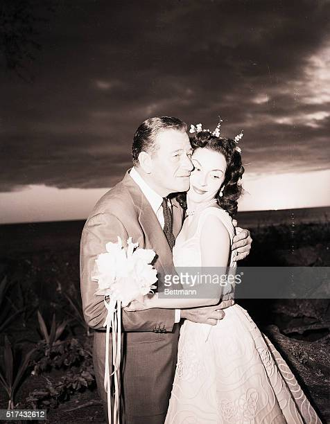 Film hero John Wayne embraces his bride Pilar Palette after the ceremony in the former home of King Kamehameha III Nov 1 The 46yearold star and his...