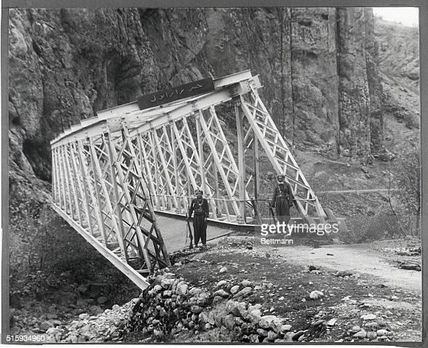 1/12/1963Kurdistan Iraq A bridge at the Gorge of Rowanduz near Chami Razan Kurdistan Iraq partially destroyed in earlier action is guarded by Kurdish...