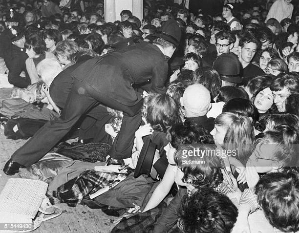 11/2/1963Manchester England The Beatles the latest rage among Britain's teenagers play a new weird kind of music that makes rock and roll seem almost...