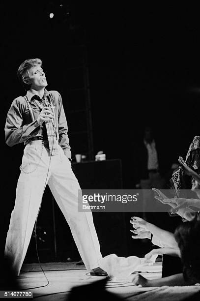 New York, NY: His glitter is gone, but British rock star David Bowie apparently still can count on a show of hands during his concert appearances. He...