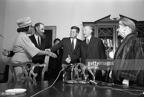 Washington, D.C.- Chancellor Konrad Adenauer, arriving at the White House today for his final conference with President Kennedy, is introduced by the...