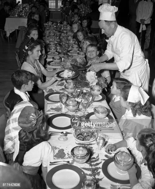 New York NY Chef Gus Bonici serves a generous slice of turkey to 15yearold Stephanie Rogacsewicz Polish war orphan as the pigtailed youngster and 49...