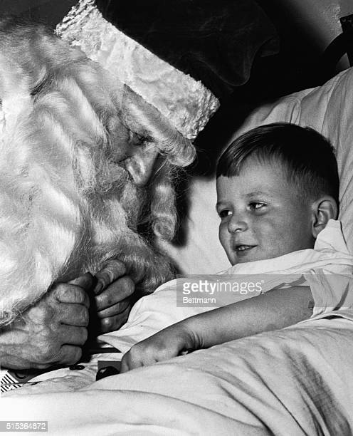 Cornwall OntarioORIGINAL CAPTION READS In the sick children's war at Cornwall's Hotel Dieu Tom Harris in the role of Santa Claus dispenses gifts and...