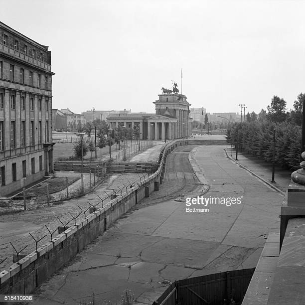 West Berlin Germany The Communist Wall in Berlin winds its way through the heart of the city against the background of the Brandenberg Gate in the...