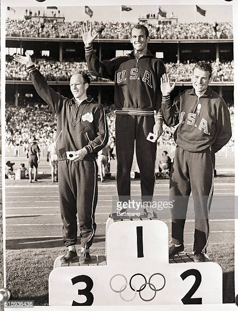 Melbourne Texas OLYMPIC GOLD AND SILVER FOR US Bobby Morrow of Abilene Texas stands on the winner's spot after he was presented with the gold medal...