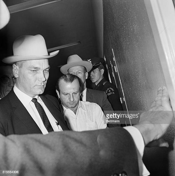 Dallas TX Jack Ruby who police say shot Lee Harvey Oswald the man who was charged with killing President John F Kennedy is led to jail after he was...