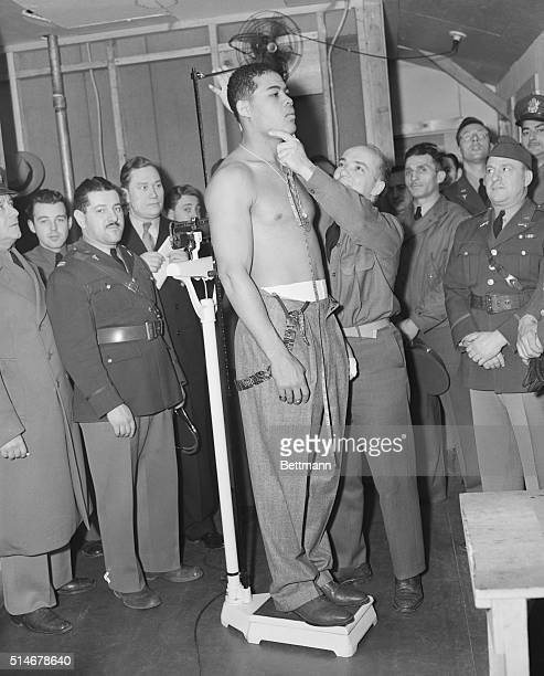 1/12/42New York New York It's six feet and two inches of champion Joe Louis as he was measured by Sgt William Chrastina during his physical...