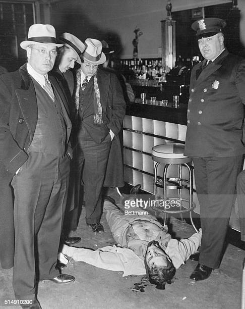 Detroit MichiganSurrounded by detectives who examined his bulletpunctured body Harry Millman former Purple gangster lies lifeless in his stillwarm...