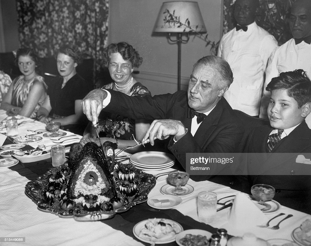 President Roosevelt Carving Thanksgiving Turkey : News Photo
