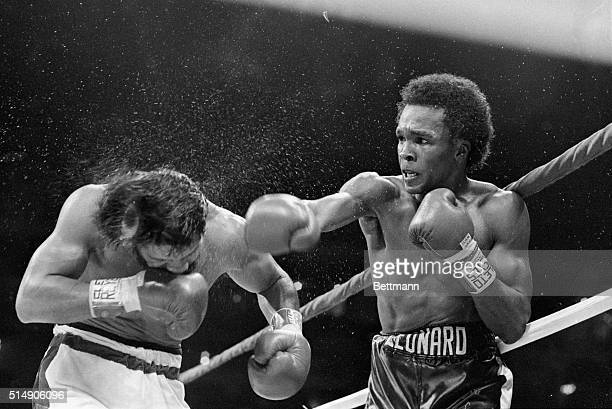 New Orleans, LA: Sugar Ray Leonard sends the perspiration flying as he hits Roberto Duran with a hard right hand during the 6th round of their...