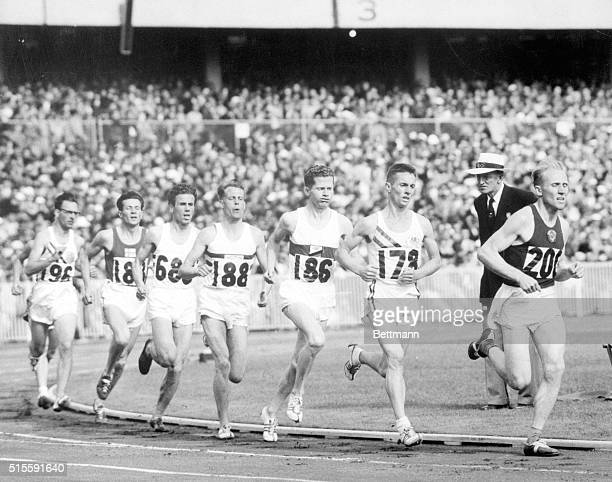 Melbourne Australia KOUTS LEADS IN 5000 METERS HEAT Photo shows the field on the bend during the second lap of the second heat in round one of the...