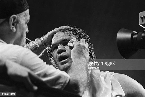Houston, Texas-: Randy Cobb gets his face worked in the late rounds of his bout with heavyweight champion Larry Holmes. Holmes dominated the fight...