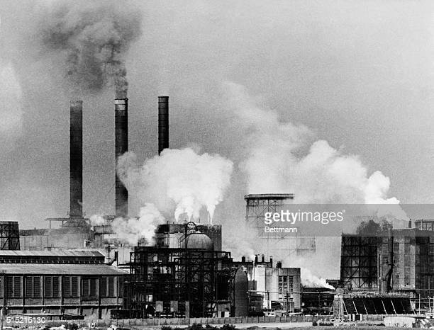 Bonn, Germany- Chimneys smoking full-blast at the Huettenwerke Oberhausen in the Ruhr district keynote Germany's industrial recovery. Her steel...