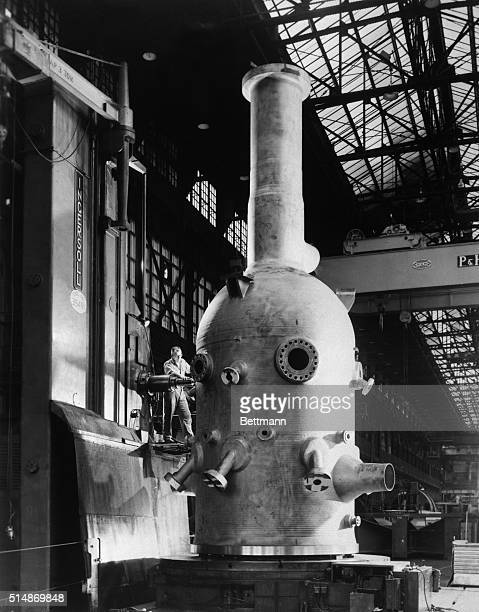 West Allis WI Resembling a huge bottle a nuclear reactor vessal is machined in the West Allis WI shop of AllisChalmers Manufacturing Company It is...