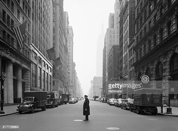 New York NY On usually bustling Fifth Avenue a lone traffic policeman stands at his post as the Red Alert signalled the start of a test Air Raid...