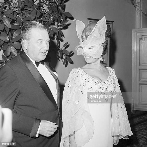 New York NY Adding to the glitter and dazzle at author Truman Capote's masked party are Mr and Mrs Henry Ford II
