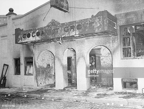Boston Massachusetts Firemen view the remains of Boston's Cocoanut Grove night club through the revolving doors leading to the tiny 10footwide...