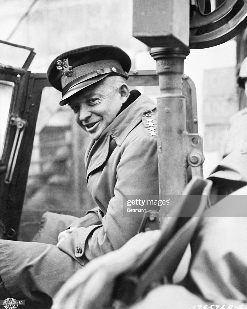 General Dwight D. Eisenhower, Supreme Allied Commander, smiles for the photographer as he starts his tour of the fighting front. The general left his closed staff car vehind because of the mud, and boarded this sturdy jeep to take him to the front lines.