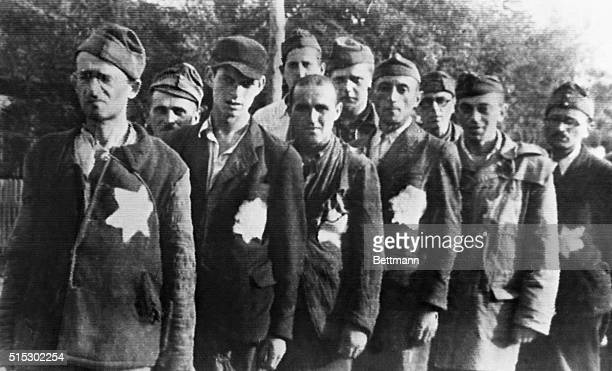 Worn and exhausted from their experiences at the hands of the Nazis is this group of Jews liberated from German camps by Red Army troops. Because of...
