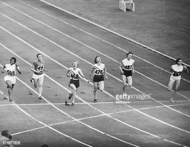 Melbourne Australia Australia's Betty Cuthbert third from left crosses the finish line to win the Women's Final 100 Meter in the Olympic Games Miss...
