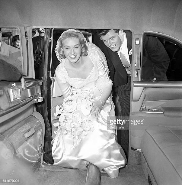 Edward Kennedy and his bride the former Joan Bennett step in to their car after their wedding
