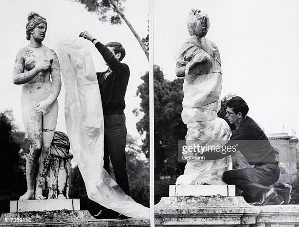 Rome Italy Demostrating his wrapit art Christo applies a polythene sheet to an ancient sculpture in Rome With the plastic sheet and some string...