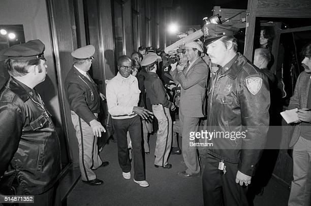 New York NY Grever Davis one of seven elderly survivers of the Jonestown mass murdersuicide who were flown back to the US walks briefly through heavy...
