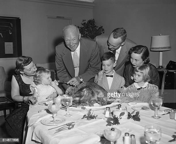 Augusta, Georgia: President Eisenhower and his family enjoy a traditional Thanksgiving dinner at the president's vacation retreat at the Augusta,...