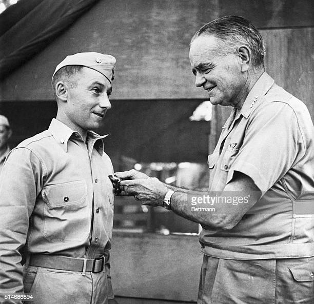 South Pacific: Admiral William F. Halsey, Commander, South Pacific Forces, as he presented the Navy Cross to Lt. Col. Victor H. Krulak, USMC, of...