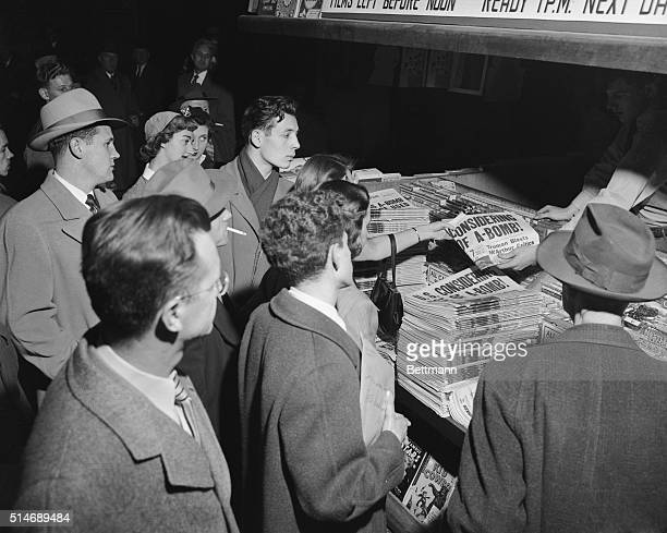 Headlines drew a crowd at the newsstand in Grand Central Station when President Truman informed the world that the United States if necessary would...