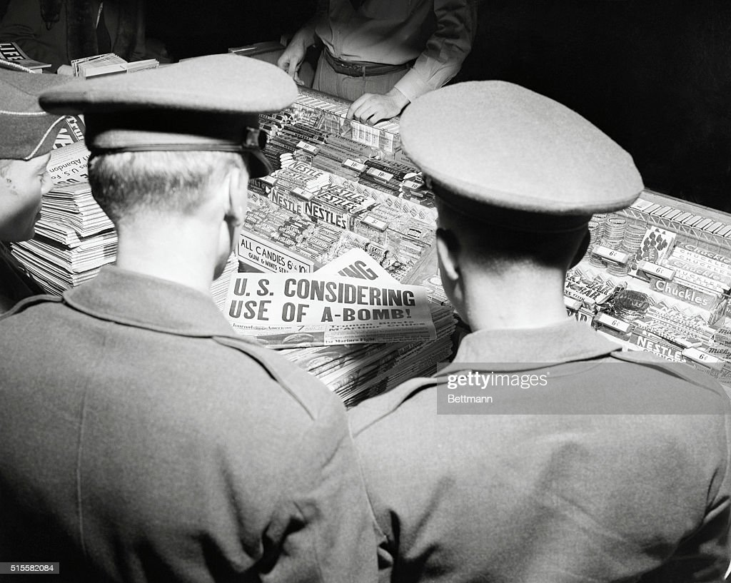 Headlines at news stand drwa crowd at Grand Central Station. Teo soldiers stop to look over the A-Bomb headlines. President Truman today informed the World that the U.S. will, if necessary, use the A-Bomb.