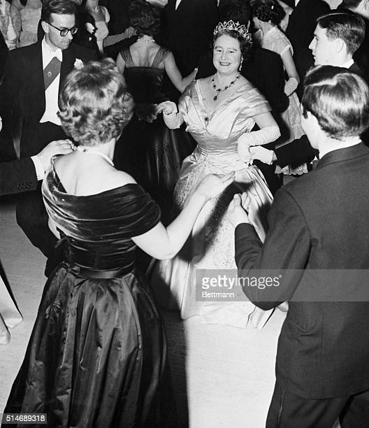 11/30/58London England England's Queen Mother smiles as she dances an eightsomereel with students at London University's Senate House Ball here Nov...