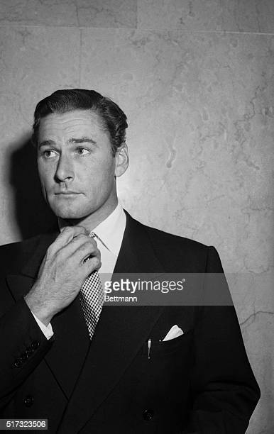 11/3/1942Los Angeles CA Film actor Errol Flynn nervously fingers his tie as he enters the Los Angeles court for preliminary hearing on charges of...