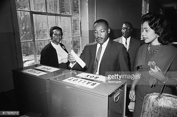 Dr Martin Luther King votes as his wife Coretta waits her turn