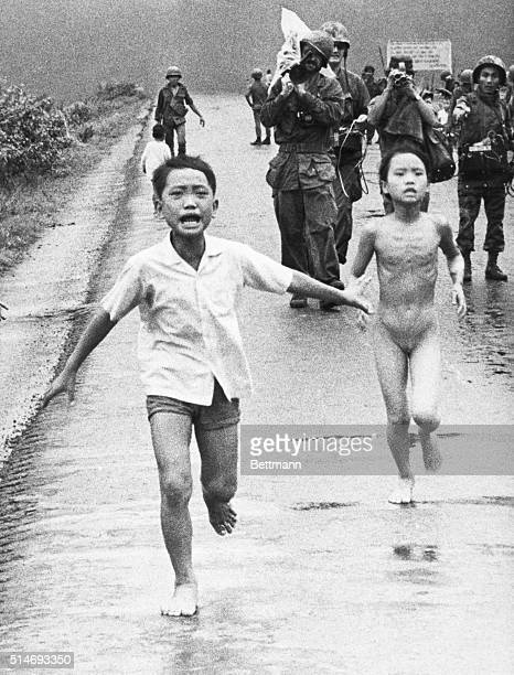 11/3/1972Trang Bang South Vietnam Children run along Highway 1 June 8 1972 in an attempt to escape an accidental napalm attack on Trang Bang 26 miles...