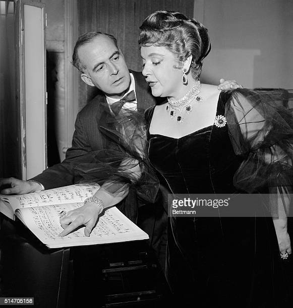 """New York: Composer Samuel Barber and star Eleanor Steber are shown as they go over the score of the opera """"Vanessa"""" at the Metropolitan Opera..."""