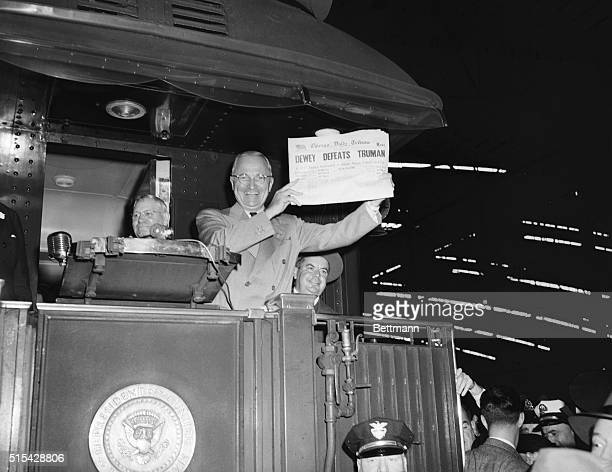 St. Louis, Mo: This photo of President Harry S. Truman laughing as he holds an early edition of the Chicago Tribune for Nov. 4th was taken by United...