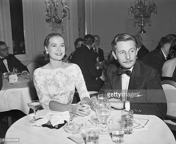 New York, NY- Actress Grace Kelly and designer Oleg Cassini are pictured attending a party given by hotel owner Julius Fleischman for Tallulah...