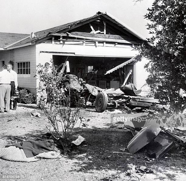 Parts of the body of William Bioff Labor racketeer lie under a blanket in the front yard of his home after a gangland bomb exploded in a pickup truck...