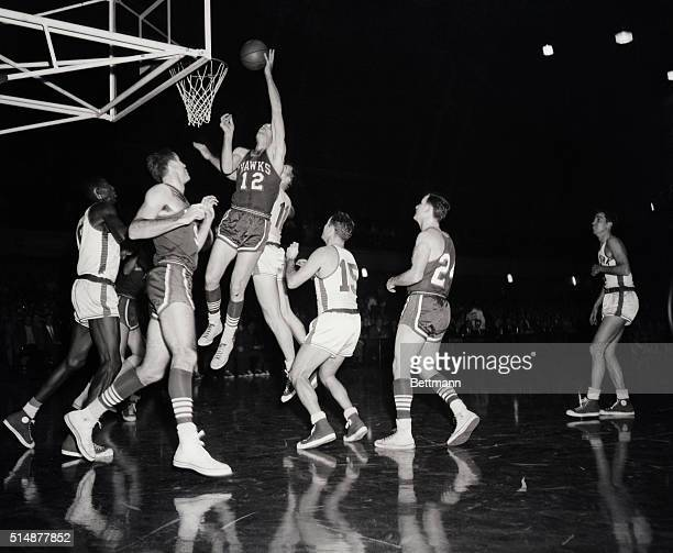 New York, NY: Big Jack Coleman lays one up for the St. Louis Hawks in the first quarter of tonight's Pro-cage game at the 69th regiment Armory....
