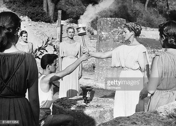 11/4/1956Olympia Greece The First Priestess of the Temple hands over the Sacred Flame to the first runner after pronouncing the Olympic Oath at the...
