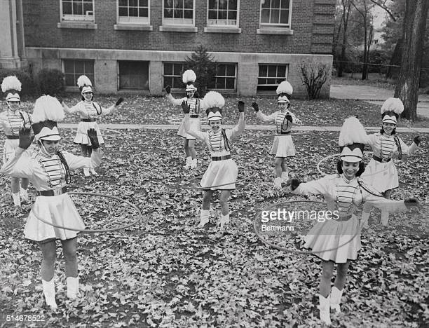 11/4/1958Claremont NH Hula Hoops have replaced batons for these twirling majorettes at Claremont NH Working it out on fallen leaves they wiggle...