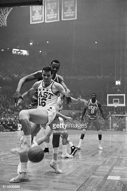 1/14/1964BostonMA 14th Annual NBA AllStar game Jerry Lucas of East team doesn't look very happy after big Wilt Chamberlain of West used his long arms...