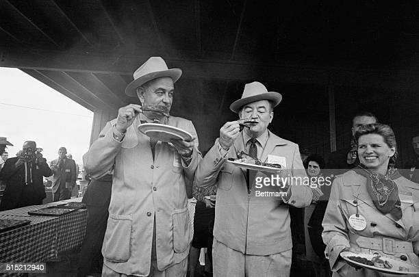 11/4/1964Johnson City TX President Lyndon B Johnson and VicePresident Elect Hubert Humphrey enjoy barbque spareribs at a barbque and victory...