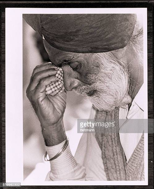 11/4/1984Photo shows an elderly Sikh man wiping tears from his eyes with a cloth