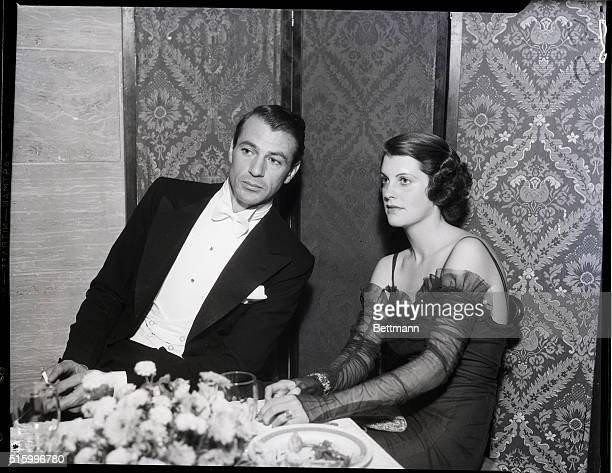 1/15/1934Los Angeles CA Gary Cooper and his wife are shown attending the first annual ball of the Screen Actors' Guild held at the Biltmore Hotel in...