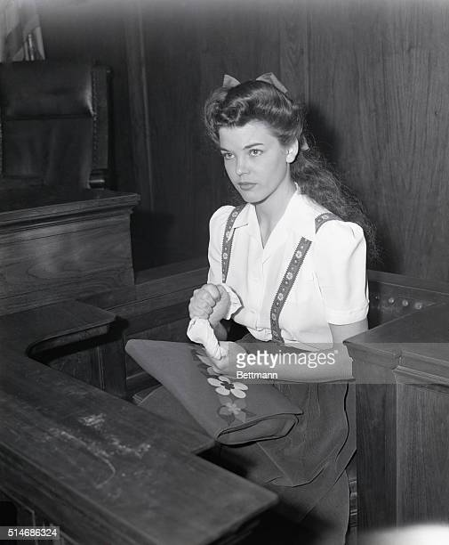 11/5/1942Los Angeles CA Nervously twisting her handkerchief Peggy Satterlee 17yearold night club dancer is shown as she testified at the trial of...